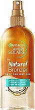 Düfte, Parfümerie und Kosmetik 2in1 Selbstbräuner-Trockenöl - Garnier Ambre Solaire Natural Bronzer Self Tan Dry Oil