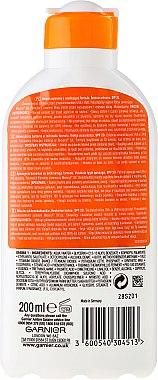 Sonnenschutzmilch SPF 20 - Garnier Ambre Solaire — Bild N2