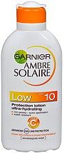 Düfte, Parfümerie und Kosmetik Wasserfeste Sonnenschutzlotion SPF 10 - Garnier Ambre Solaire Protection Lotion