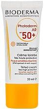 Düfte, Parfümerie und Kosmetik Getönte und beruhigende Sonnenschutzcreme gegen Rötungen für das Gesicht SPF 50+ - Bioderma Photoderm AR Spf 50+ Tinted Sun Cream