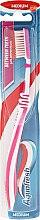 Zahnbürste mittel Between Teeth rosa-weiß - Aquafresh Between Teeth Medium — Bild N1