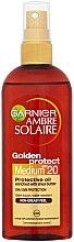Düfte, Parfümerie und Kosmetik Schützendes Ölspray für den Körper mit Sheabutter SPF 20 - Garnier Ambre Solaire Golden Protect Oil SPF 20