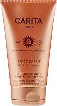 Feuchtigkeitsspendende Körper Sonnenschutzmilch SPF 20 - Carita Progressif Anti-Age Solaire — Bild N2