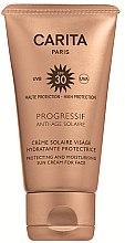 Düfte, Parfümerie und Kosmetik Anti-Aging Gesichtscreme mit Sonnenschutz SPF 30 - Carita Progressif Anti-Age Solaire Protecting And Moisturising Sun Cream For Face